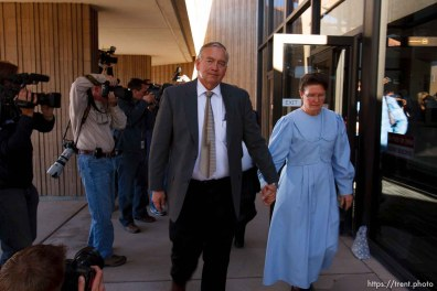 St. George - Lamar Johnson and an unidentified woman (would not give her name), supporters of Warren Jeffs, leave the 5th District Courthouse after the sentencing of polygamous sect leader Warren Jeffs. Jeffs was sentenced Tuesday to two consecutive counts of 5 years to life, November 20, 2007 after being found guilty on two counts of rape as an accomplice, in St. George, Utah. Jeffs, head of the Fundamentalist Church of Jesus Christ of Latter Day Saints, was found guilty of two counts of rape as an accomplice for allegedly coercing the marriage and rape of a 14-year-old follower to her 19-year-old cousin in 2001.