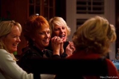 """Salt Lake City - Members of the Blue Thong Society's Park City chapter trade jokes over dinner. Left to right: Nancy Ramaley, Nancy Haga, Debra Harris, Deanna Colaizzi (back to camera) and Cheryl Leonard. The Blue Thong Society is the Baby Boomers' alternative to the Red Hat Society. Their mission is to """"fight the frump,"""" while providing women a chance to socialize and do good works. Blue Thongaritas and Blue Martinis are the drink of choice. Utah has three chapters. The Park City chapter met at Cheryl Leonard's Salt Lake City home Wednesday, November 18, 2007, to socialize, drink blue drinks and have fun."""
