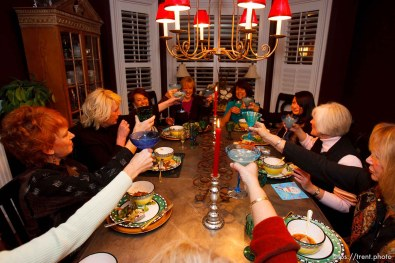 """Salt Lake City - Members of the Blue Thong Society's Park City chapter raise their Blue Thongaritas for a toast to kick off dinner. Left to right: Nancy Haga, Debra Harris, MaryAnn Mackley, Cheryl Leonard, Miki Laus, Cynthia Sulprizio, Barbara Maben, and Sandra Ramsey. The Blue Thong Society is the Baby Boomers' alternative to the Red Hat Society. Their mission is to """"fight the frump,"""" while providing women a chance to socialize and do good works. Blue Thongaritas and Blue Martinis are the drink of choice. Utah has three chapters. The Park City chapter met at Cheryl Leonard's Salt Lake City home Wednesday, November 18, 2007, to socialize, drink blue drinks and have fun."""