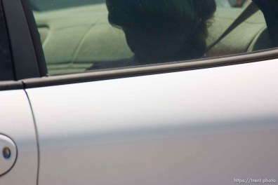 """Eldorado - Young FLDS woman leaving civic center in small car during raid on the FLDS YFZ """"Yearning for Zion"""" compound outside of Eldorado, Texas, Saturday, April 5, 2008. CPS"""