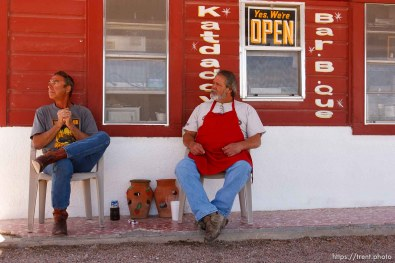 """Eldorado - """"Jimmy"""" (left) and """"Katdaddy"""" take in the afternoon out in front of Katdaddy's Bar-B-Que Saturday, April 5, 2008. Katdaddy says he's glad that Texas Child Protective Services has removed children from the FLDS YFZ """"Yearning for Zion"""" compound just outside of town, after allegations of child abuse."""