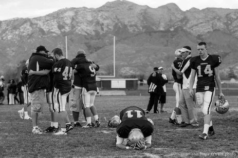 Highland - Lone Peak players console each other after the season-ending loss. At center is Chase Dunford (11) and at right is Jared Hultquist (14). Lone Peak loses to Skyline in high school football playoff action Friday, October 31, 2008, at Lone Peak.