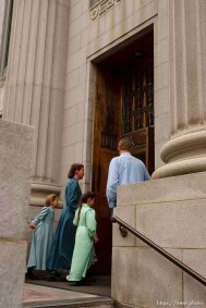 Salt Lake City - Salt Lake City - FLDS members enter the Federal Courthouse Wednesday November 12, 2008 where Judge Dee Benson did not issue a ruling to stop the proposed sale of UEP land including Berry Knoll, a site the FLDS say has religious value. 11.12.2008