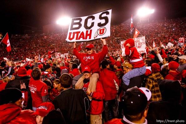 Salt Lake City - . Utah vs. BYU college football Saturday, November 22, 2008 at Rice-Eccles Stadium. Saturday November 22, 2008. utah fans swarm the field. Utah quarterback Brian Johnson (3)