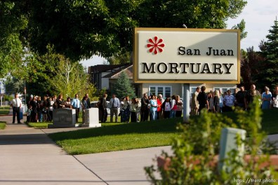 Blanding - Hundreds turned out to the San Juan Mortuary Monday evening, June 15, 2009 to pay their respects at the viewing of Blanding physician James Redd, who took his own life after being charged with a felony count of trafficking in archaeological artifacts protected by federal law.