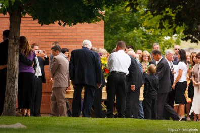 Blanding - Hundreds turned out to the LDS Stake Center in Blanding Tuesday, June 16, 2009 to pay their respects at the funeral of physician James Redd, who took his own life after being charged with a felony count of trafficking in archaeological artifacts protected by federal law.