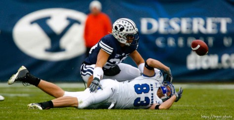 Trent Nelson | The Salt Lake Tribune The ball gets away from Air Force's Kevin Fogler (83), with BYU's Lee Aguirre (20) defending. BYU vs. Air Force college football Saturday, November 21 2009.