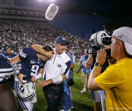 Trent Nelson | The Salt Lake Tribune BYU quarterbacks coach Brandon Doman celebrates the win with quarterback Jake Heaps. BYU vs. Washington, college football at Lavell Edwards Stadium in Provo, Saturday, September 4, 2010.