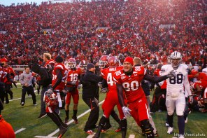 Trent Nelson | The Salt Lake Tribune Fans flood the field after the Utes beat BYU on a blocked field goal attempt at Rice-Eccles Stadium Saturday, November 27, 2010. The final score was Utah 17-BYU 16.