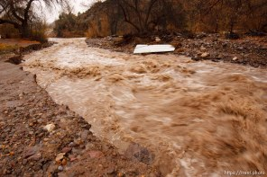Trent Nelson | The Salt Lake Tribune A road washed out by Beaver Dam Wash in Motoqua, Utah, Wednesday, December 22, 2010.