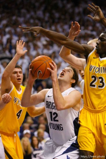 Trent Nelson | The Salt Lake Tribune BYU's Logan Magnusson looks for a shot with Wyoming's Francisco Cruz, left, and Wyoming's Djibril Thiam defending as BYU hosts Wyoming, college basketball in Provo, Utah, Saturday, March 5, 2011.