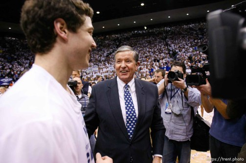 Trent Nelson | The Salt Lake Tribune BYU's Jimmer Fredette and BYU president Cecil Samuelson as BYU hosts Wyoming, college basketball in Provo, Utah, Saturday, March 5, 2011. boyd ivey