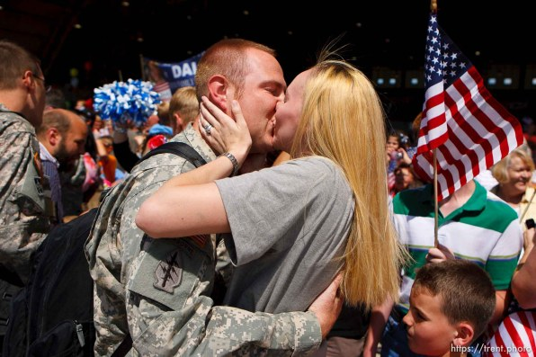Trent Nelson | The Salt Lake Tribune Kristin Hansen welcomes her husband Jeremy home with a kiss as the Utah National Guard's 141st Military Intelligence Battalion returned to Salt Lake City, Utah, from duty in Iraq Wednesday, June 15, 2011. Some 275 soldiers of the 141st deployed in June last year.