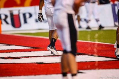 Trent Nelson | The Salt Lake Tribune Herriman's David Christensen pukes. Herriman vs. Riverton High School football at Rice-Eccles Stadium in Salt Lake City, Utah, Saturday, August 27, 2011.