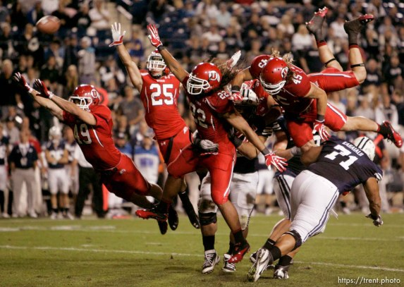 Trent Nelson | The Salt Lake Tribune Utah punt block attempt, Utah's Trevor Reilly (49), Mike Honeycutt (25), Thretton Palamo (22), Boo Andersen (45). BYU vs. Utah football in Provo, Utah, Saturday, September 17, 2011.