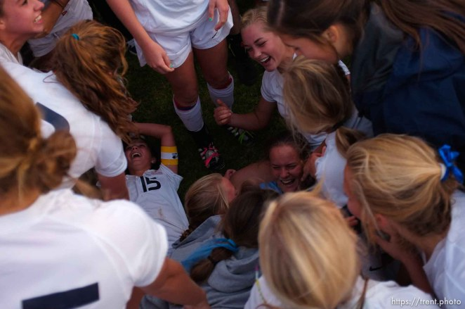 Trent Nelson | The Salt Lake Tribune Skyline fans and players dogpile on goalkeeper Alli Spencer after she scored the winning goal. Skyline defeats Bountiful in a shootout, high school soccer playoffs, in Herriman, Utah, Thursday, October 13, 2011.
