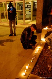 Trent Nelson | The Salt Lake Tribune Justin Kramer lights candles in front of the Public Safety Building in Salt Lake City, Utah on Wednesday, October 26, 2011. About two dozen protesters with Occupy Salt Lake marched from Pioneer Park to the Public Safety Building. They lit candles to show appreciation for the Salt Lake City police, but to protest the actions of the police in Oakland (California).