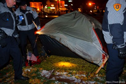Trent Nelson | The Salt Lake Tribune Salt Lake City police search tents as they clear the Occupy Salt Lake tent city from Pioneer Park in Salt Lake City, Utah, Saturday, November 12, 2011.