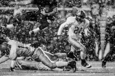 Trent Nelson | The Salt Lake Tribune Hurricane vs. Desert Hills in the 3A State Championship high school football game at Rice-Eccles Stadium in Salt Lake City, Utah, Friday, November 18, 2011. Brian Scott leaps over defense