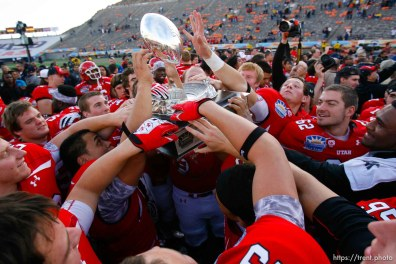 Trent Nelson | The Salt Lake Tribune Utah players celebrate with the trophy as the University of Utah defeated Georgia Tech, college football at the Sun Bowl in El Paso, Texas, Saturday, December 31, 2011.