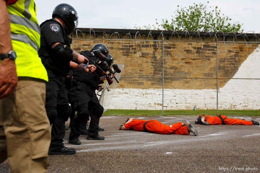 Trent Nelson | The Salt Lake Tribune Weber State students Rachel Taylor, left, and Sarah Cleverley lie prone, role playing as inmates while an emergency response team from the Chemung County (NY) Sheriff's Office moves in during a training scenario at the Mock Prison Riot, Monday, May 7, 2012 at the West Virginia Penitentiary in Moundsville, West Virginia.