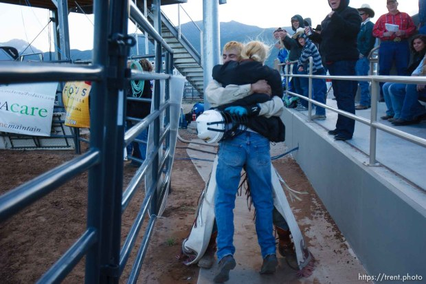 Trent Nelson | The Salt Lake Tribune Justin Gardner embraces his mother Brandy Wilcken after his ride in the bull riding competition at the Utah High School Rodeo Finals Saturday, June 9, 2012 in Heber City, Utah.