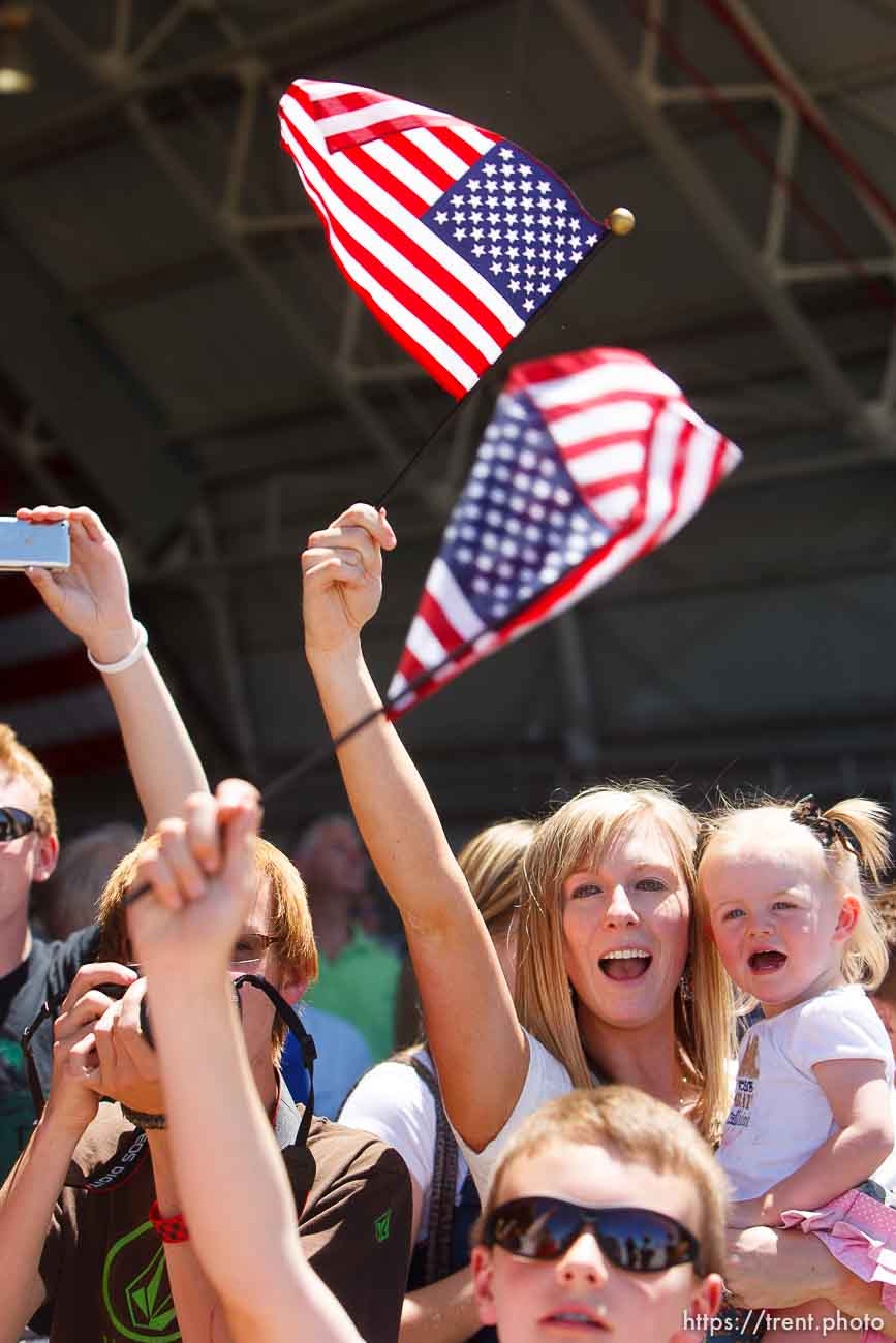 Trent Nelson | The Salt Lake Tribune Amy Healey, holding her daughter Jayci, waves a flag as the soldiers from the Utah Army National Guard's Second Battalion, 211th Aviation unit returned from a 12-month deployment to Afghanistan, Saturday, June 23, 2012 in Salt Lake City, Utah.