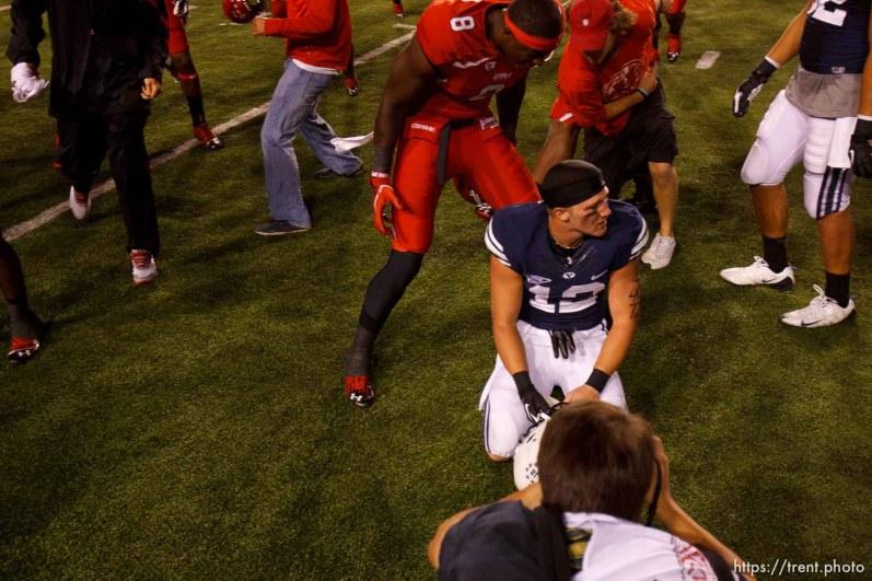 Trent Nelson | The Salt Lake Tribune Utah players celebrate the win around Brigham Young wide receiver JD Falslev (12) as Utah hosts BYU college football in Salt Lake City, Utah, Saturday, September 15, 2012. chris detrick