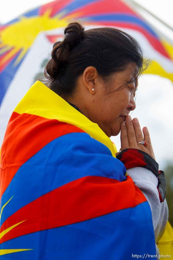 Trent Nelson | The Salt Lake Tribune Tsering Chadon cries during a prayer as approximately sixty people turned out to show their support for human rights inTibet Wednesday October 24, 2012 at the state capitol in Salt Lake City, Utah. The rally was part of the Flame of Truth Relay, a worldwide torch relay to highlight dozens of Tibetan self-immolations since 2009 and promote a response from the United Nations.