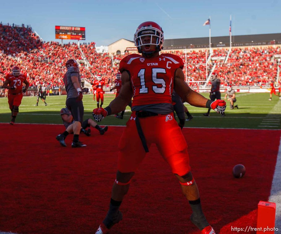 Trent Nelson | The Salt Lake Tribune Utah running back John White (15) celebrates a touchdown run as Utah hosts Washington State, college football at Rice-Eccles Stadium Saturday November 3, 2012 in Salt Lake City.