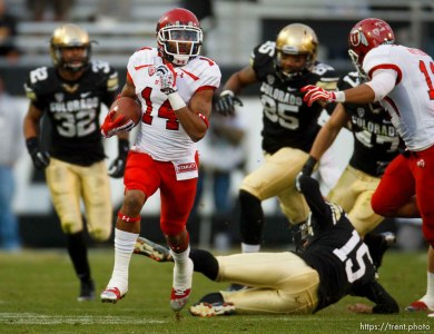 Trent Nelson   The Salt Lake Tribune Utah Utes wide receiver Reggie Dunn (14) returns a kick for a touchdown in the fourth quarter as the Colorado Buffaloes host the University of Utah Utes, college football Friday November 23, 2012 in Boulder.