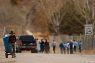 Trent Nelson | The Salt Lake Tribune A young man pulling trash on a wagon, Friday November 30, 2012 in Hildale.