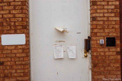 Numerous court summons and notices on the door to Jeffs compound in Hildale Friday November 30, 2012