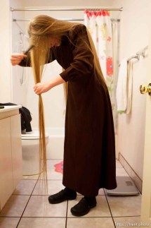Trent Nelson | The Salt Lake Tribune Allie Steed does her hair, on Saturday December 1, 2012 in Colorado City. The three young women recently left the FLDS church.