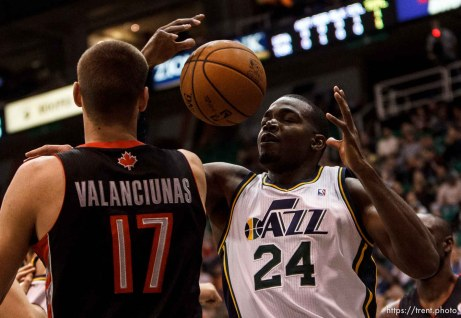 Trent Nelson | The Salt Lake Tribune Utah Jazz power forward Paul Millsap (24) pulls down a rebound ahead of Toronto Raptors center Jonas Valanciunas (17) as the Utah Jazz face the Toronto Raptors Friday December 7, 2012.
