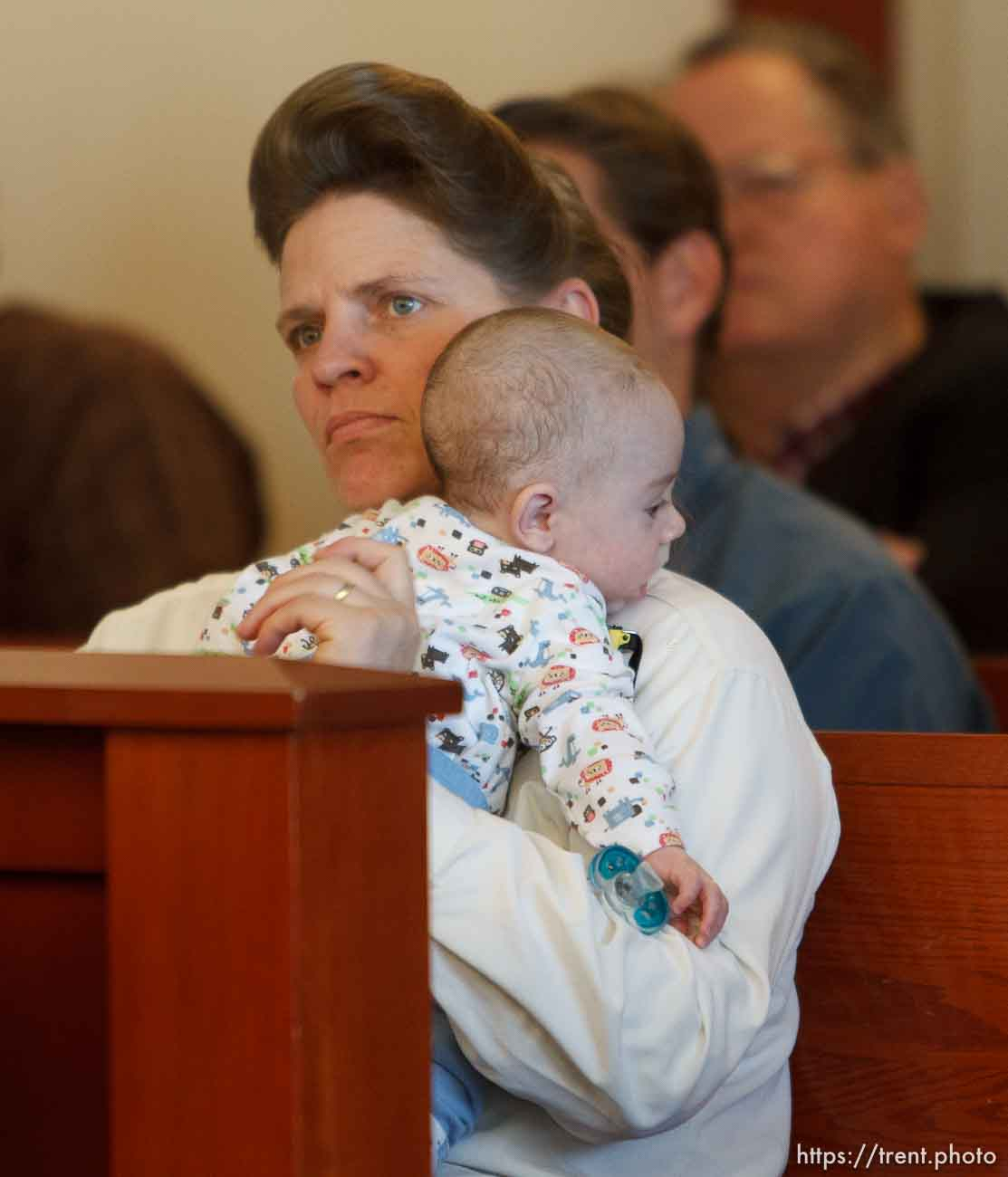 Trent Nelson   The Salt Lake Tribune Joanna Jessop listens while holding an infant during a court hearing on the polygamous UEP land trust, Friday April 12, 2013 in Salt Lake City.