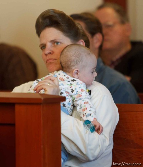 Trent Nelson | The Salt Lake Tribune Joanna Jessop listens while holding an infant during a court hearing on the polygamous UEP land trust, Friday April 12, 2013 in Salt Lake City.
