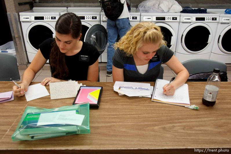 Trent Nelson   The Salt Lake Tribune Missionaries Amanda Stokes and Holly King write letters home while doing laundry at the Missionary Training Center of the Church of Jesus Christ of Latter-day Saints in Provo Tuesday June 18, 2013.