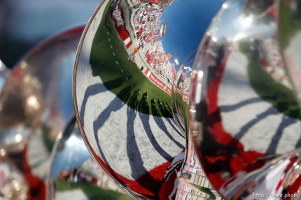 Trent Nelson | The Salt Lake Tribune Fans and the stadium reflected in a Utah Marching Band tuba as the University of Utah hosts Utah State, college football Thursday, August 29, 2013 at Rice-Eccles Stadium in Salt Lake City.