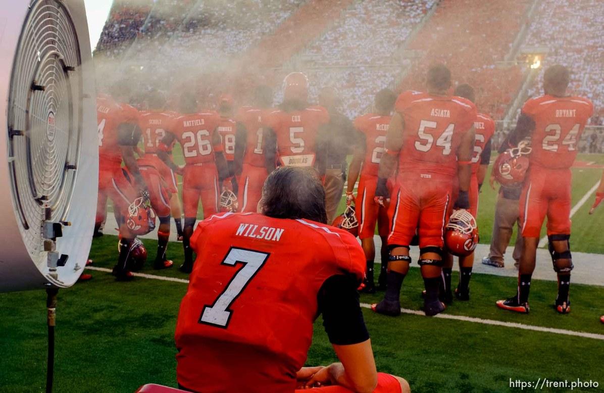 Trent Nelson | The Salt Lake Tribune Utah Utes quarterback Travis Wilson (7) gets a blast of cold air on the bench as the University of Utah hosts Utah State, college football Thursday, August 29, 2013 at Rice-Eccles Stadium in Salt Lake City.
