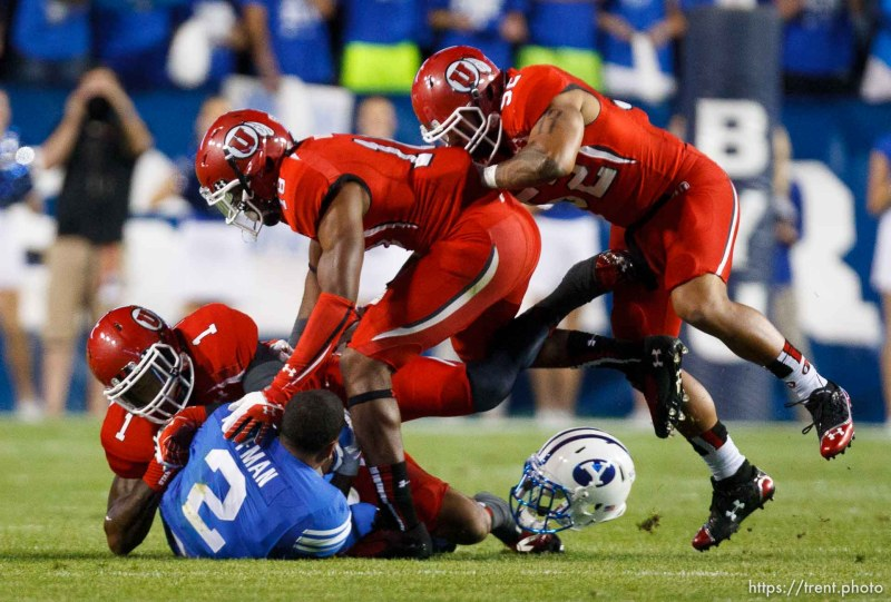 Trent Nelson | The Salt Lake Tribune Brigham Young Cougars wide receiver Cody Hoffman (2) has his helmet knocked off by Utah defenders in the first quarter as the BYU Cougars host the Utah Utes, college football Saturday, September 21, 2013 at LaVell Edwards Stadium in Provo.