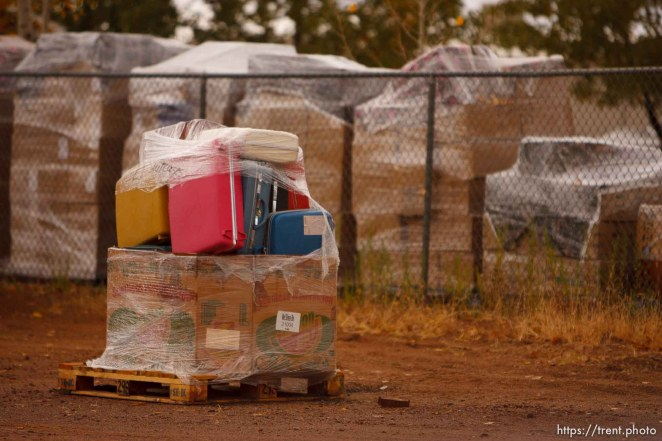 Trent Nelson | The Salt Lake Tribune supplies wrapped up on pallets for transport in Hildale Thursday, October 10, 2013. suitcases