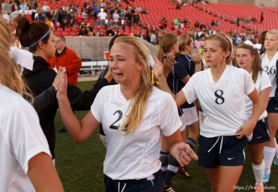Trent Nelson | The Salt Lake Tribune Waterford players tearfully congratulate Summit players after the game Summit Academy takes the 2A high school girls' soccer state championship game at Rio Tinto Stadium in Sandy, Saturday October 26, 2013. Caroline Coats is #21.