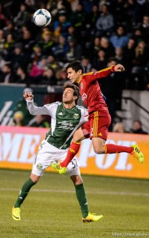Trent Nelson | The Salt Lake Tribune Real Salt Lake's Tony Beltran (2) heads the ball over Portland's Maximiliano Umuti (37) as Real Salt Lake faces the Portland Timbers, MLS soccer Sunday November 24, 2013 in Portland.