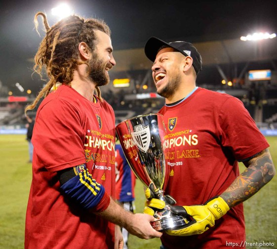 Trent Nelson | The Salt Lake Tribune Real Salt Lake's Kyle Beckerman (5), Real Salt Lake's Nick Rimando (18) holds the trophy after Real Salt Lake defeated the Portland Timbers, MLS soccer Sunday November 24, 2013 in Portland.