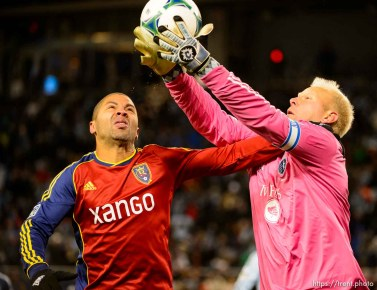 Trent Nelson | The Salt Lake Tribune RSL's Alvaro Saborio and Sporting KC's Jimmy Nielsen (1) leap for the ball as Real Salt Lake faces Sporting KC in the MLS Cup Final at Sporting Park in Kansas City, Saturday December 7, 2013.