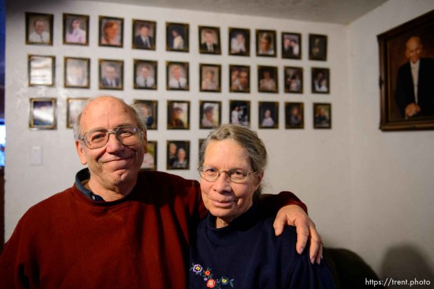 Trent Nelson | The Salt Lake Tribune Marvin and Charlette Wyler in their Hildale home, Saturday December 14, 2013. On the wall behind them are portraits of Marvin's 34 children, and polygamist leader Leroy Johnson.