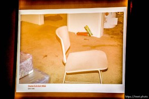 Trent Nelson | The Salt Lake Tribune A photo showing blood on the floor the basement of the apartment where Hser Ner Noo was found, displayed during the murder trial of Esar Met in Salt Lake City, Tuesday January 7, 2014. Met is accused of killing 7-year-old Hser Ner Moo in 2008