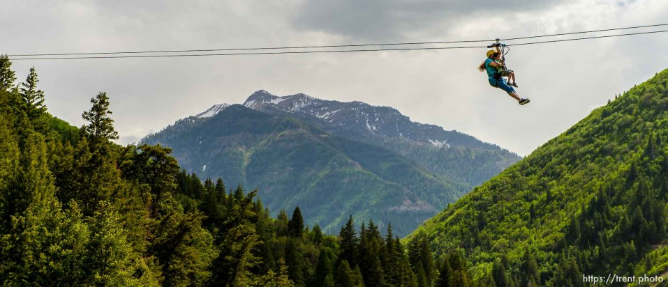Trent Nelson | The Salt Lake Tribune Stacy and Asa Davis take a ride above Provo Canyon at Max Zipline, Saturday May 31, 2014.