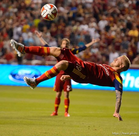 Trent Nelson | The Salt Lake Tribune Real Salt Lake's Luke Mulholland (19) takes a bicycle kick, narrowly missing the score, as Real Salt Lake hosts Vancouver Whitecaps FC at Rio Tinto Stadium in Sandy, Saturday July 19, 2014.